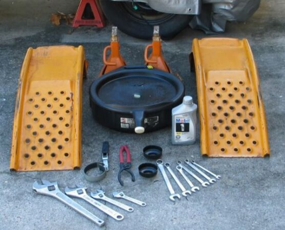 What tools are used to change oil at home